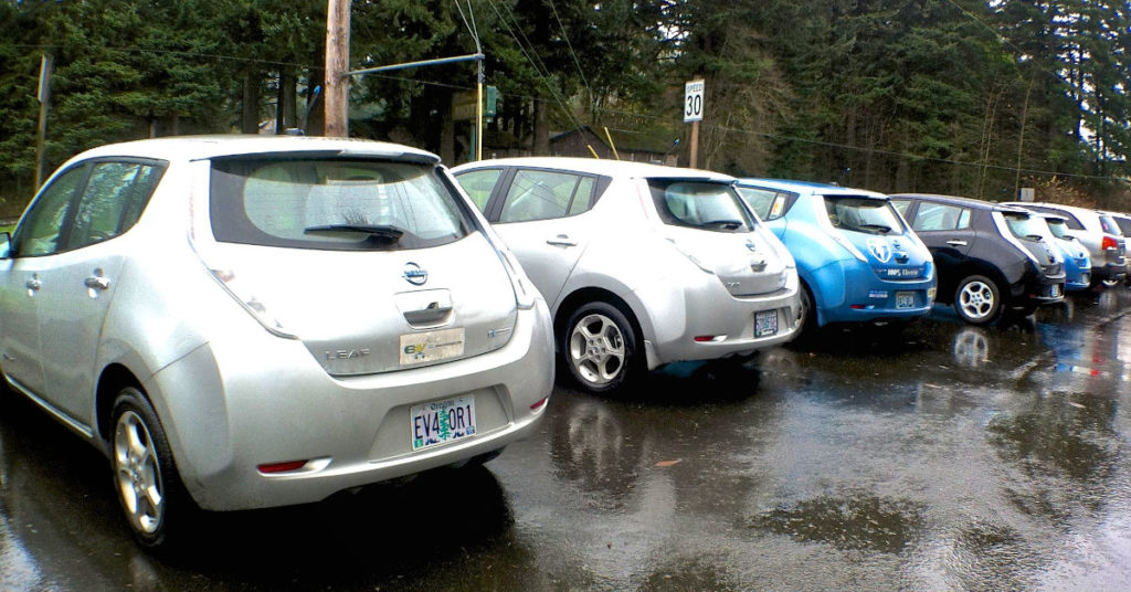 A line of Nissan Leaf electric vehicles
